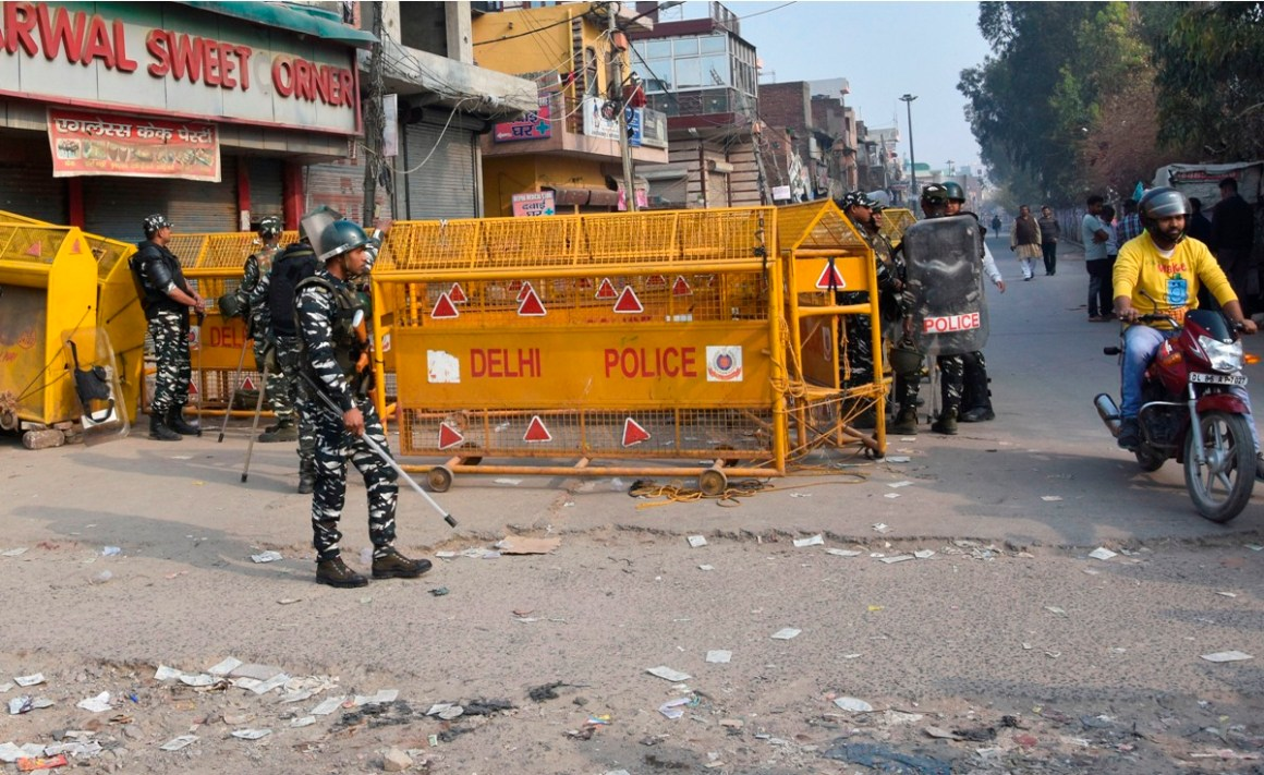 New Delhi: Security personnel stand guard on the Chand Bagh - Bhajan Pura road in northeast Delhi, Tuesday, Feb. 25, 2020. At least 7 people have been killed in clashes over the new citizenship law. (PTI Photo)   (PTI2_25_2020_000068B)