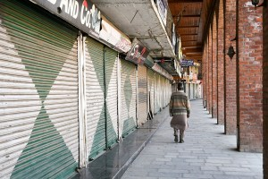 Srinagar: A man walks outside closed shops during restrictions in Srinagar, Friday, March 20, 2020. Authorities imposed restrictions on second day as a precautionary measures after first case of coronavirus was detected in the Valley. (PTI Photo/S. Irfan)(PTI20-03-2020 000132B)