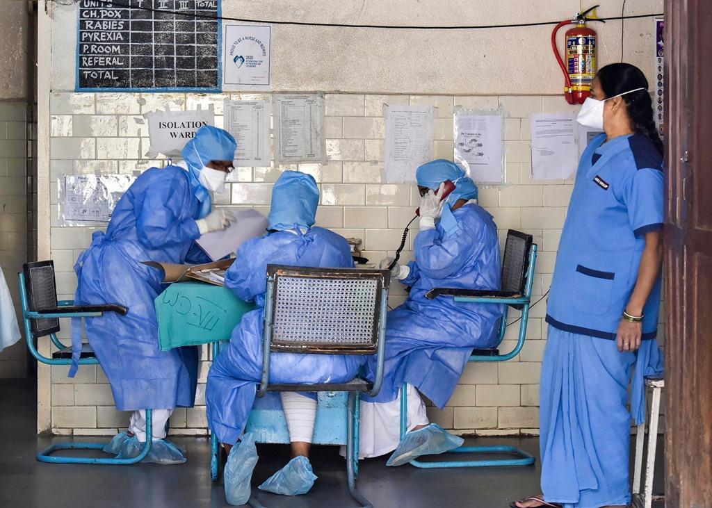 Hyderabad: Medics outside an isolation ward of the novel coronavirus (COVID-19) at a hospital in Hyderabad, Friday, March 13, 2020. India has more than 70 positive coronavirus cases so far and recorded its first COVID-19 death in Karnataka. (PTI Photo)(PTI13-03-2020_000060B)