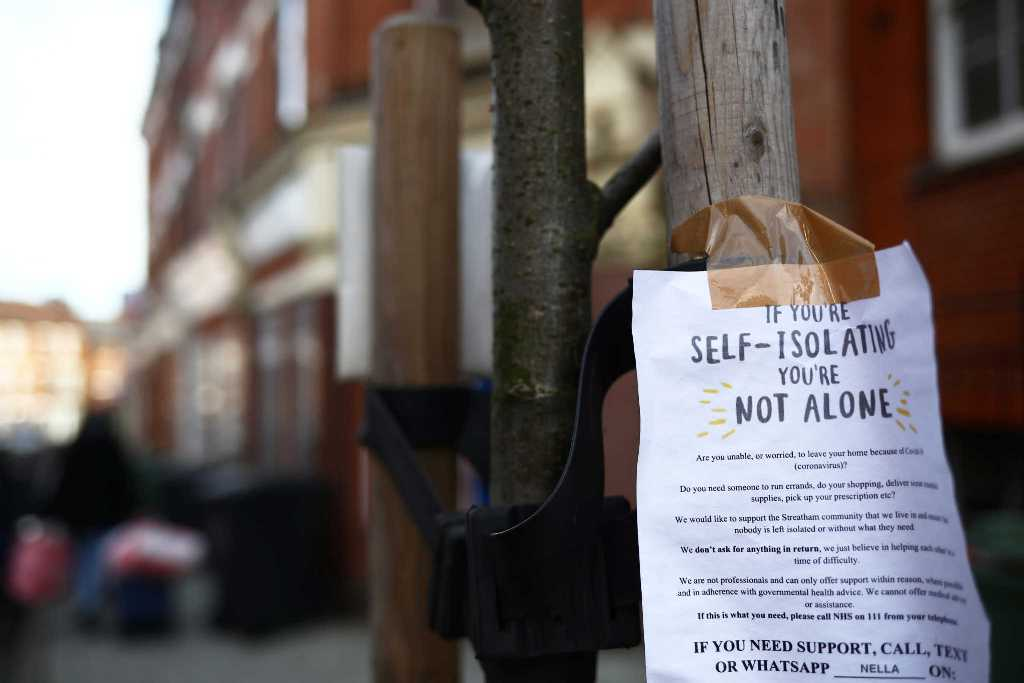 A sign is seen down a London street regarding self isolation as the spread of the coronavirus disease (COVID-19) continues. London, Britain March 21, 2020 REUTERS/Hannah Mckay