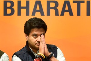 New Delhi: Former Congress leader Jyotiraditya Scindia greets as he arrives to join Bharatiya Janata Party (BJP), at party headquarters in New Delhi, Wednesday, March 11 , 2020. (PTI Photo/Arun Sharma) (PTI11-03-2020_000124B)