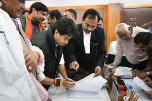 Bhopal: BJP leader Jyotiraditya Scindia files his nomination papers to Returning Officer AP Singh for Rajya Sabha elections, at Madhya Pradesh Assembly in Bhopal, Friday, March 13, 2020. (PTI Photo)(PTI13-03-2020_000038B)