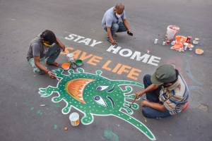 Kolkata: Artists paint graffiti on a road to raise awareness about the COVID-19 during nationwide lockdown imposed to contain the coronavirus pandemic, in Kolkata, Thursday, April 9, 2020. (PTI Photo/Swapan Mahapatra) (PTI09-04-2020_000142B)