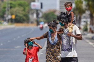 Mumbai: A family wearing face masks walk along a road during the nationwide lockdown, imposed in the wake of the coronavirus pandemic, at Worli in Mumbai, Thursday, April 9, 2020. (PTI Photo/Kunal Patil)(PTI09-04-2020_000174B)