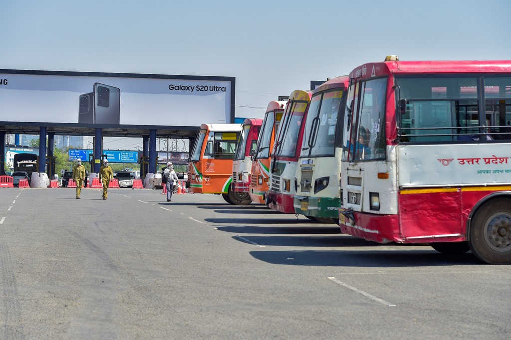 Noida: UP Roadways buses parked at DND toll plaza to carry migrants to their native places, during the ongoing nationwide COVID-19 lockdown, in Noida, Wednesday, May 20, 2020. (PTI Photo/Vijay Verma)(PTI20-05-2020 000128B)