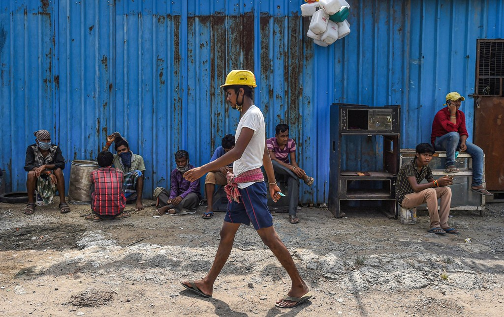 Chennai: Migrant labourers during a protest amid a government-imposed nationwide lockdown as a preventive measure against the coronavirus, in Chennai, Saturday, May 2, 2020. The workers were demanding clearance of pending dues, food and shelter. (PTI Photo)(PTI02-05-2020_000205B)