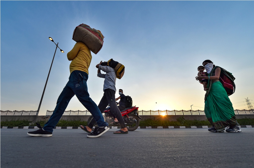 New Delhi: Migrant workers along with their family members walk along the Delhi-UP border road during the ongoing COVID-19 nationwide lockdown, in East Delhi, Tuesday, May 5, 2020. (PTI Photo/Manvender Vashist) (PTI05-05-2020_000233B)