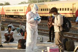 Bhopal: Thermal screening of migrant workers being conducted after they arrive from Nashik by a special train at Misrod railway station, during the ongoing COVID-19 lockdown, in Bhopal, Saturday, May 02, 2020. This is the first special train that has reached Bhopal after the Centres announcement to run such services to facilitate the stranded workers. (PTI Photo) (PTI02-05-2020 000022B)
