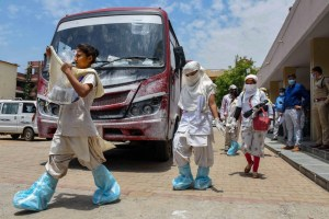Ranchi: Health workers wearing PPE kits on their way to screen the residents of Hindpiri area to detect COVID-19 cases, during the ongoing COVID-19 lockdown, in Ranchi, Wednesday, May 27, 2020. (PTI Photo)(PTI27-05-2020 000062B)