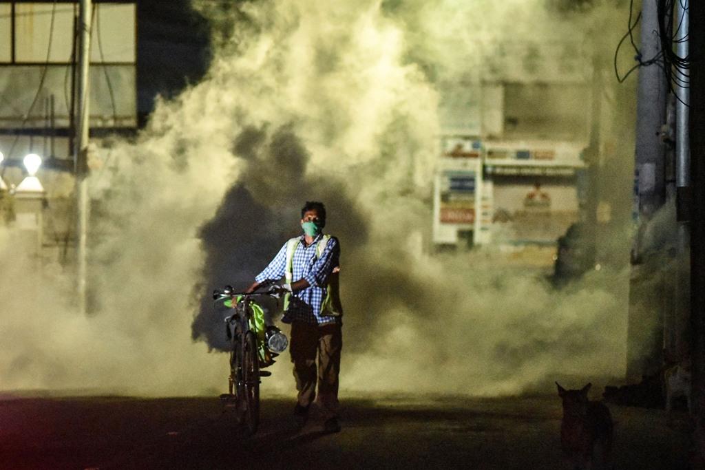 Vijayawada: A corporation worker fumigates chemical smoke during fumigation drive amid the ongoing COVID-19 lockdown, in Vijayawada, Monday, May 25, 2020. (PTI Photo)(PTI25-05-2020 000368B)