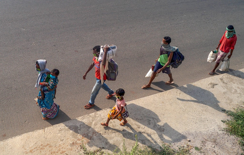 Bhubaneswar: A migrant family walks along the national highway (NH-16) to reach the native place, during ongoing COVID-19 lockdown, in Bhubaneswar, Monday, May 18, 2020. (PTI Photo) (PTI18-05-2020 000088B)