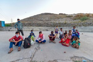 Ghaziabad: Migrants wait at a roadside after police stopped them at the Ghazipur border, during ongoing COVID-19 lockdown, in Ghaziabad, Wednesday, May 20, 2020. (PTI Photo/Vijay Verma) (PTI20-05-2020_000271B)