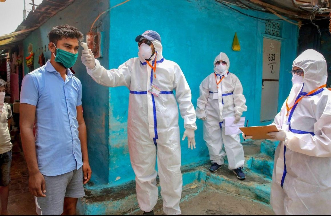 A team of doctors wearing protective suits check slum dwellers during a house-to-house health survey at Vallabh Nagar during the nationwide lockdown imposed in wake of the coronavirus pandemic in Bhopal Monday April 20 2020. (Photo | PTI)