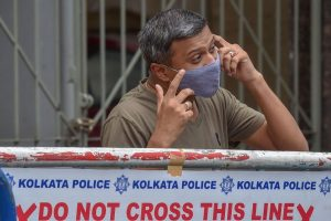 Kolkata: A resident speaks on the phone outside a sealed residential complex at Bhawanipore area, following emergence of COVID-19 cases, during Unlock 2.0, in Kolkata, Saturday, July 18, 2020. (PTI Photo/Swapan Mahapatra)(PTI18-07-2020 000068B)