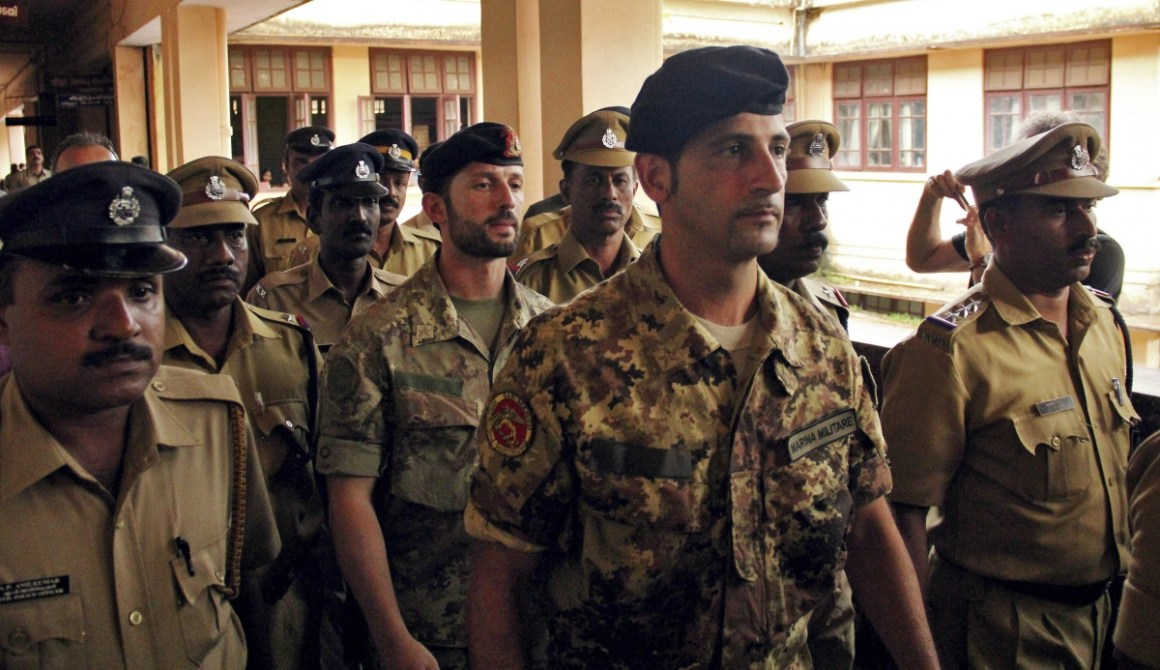 Salvatore Girone (C) and Latorre Massimiliano (3rd R), members of the navy security team of Napoli registered Italian merchant vessel Enrica Lexie, are escorted as they leave a courtroom at Kollam in Kerala March 5, 2012. Credit: Reuters/Sivaram V/Files