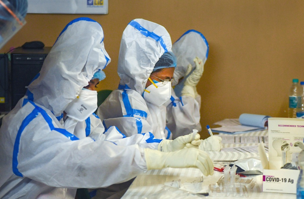 Kolkata: Kolkata Municipal Corporation (KMC) health workers prepare before collecting swab samples of residents for COVID-19 test, at a residential society in Kolkata, Sunday, Aug. 23, 2020. (PTI Photo/Ashok Bhaumik)(PTI23-08-2020 000042B)