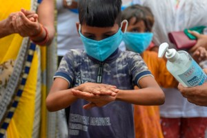 Mumbai: Volunteers offer hand-wash training to children during a campaign to mark Global Hand Washing Day, at Dharavi in Mumbai, Thursday, Oct. 15, 2020. (PTI Photo/Kunal Patil) (PTI15-10-2020 000087B)