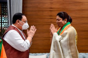 New Delhi: BJP National President JP Nadda greets Tamil film actress and former Congress spokesperson Khushbu Sundar, who joined BJP, at party HQ in New Delhi, Monday, Oct. 12, 2020. (PTI Photo/Kamal Singh)(PTI12-10-2020 000076B)
