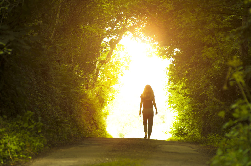 Girl walking towards the light