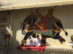 5. Local wall mural and men in traditional attire