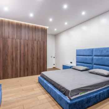 bedroom with bed and wardrobe