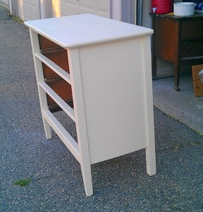 Wallpaper dresser before with a coat of paint