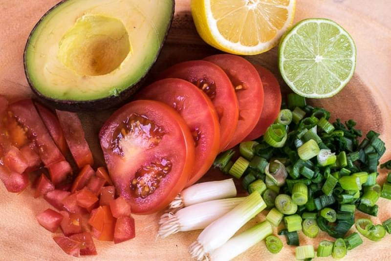picture of cut up ingredients for guacamole