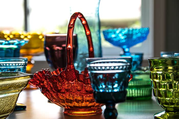 Picture showing various pressed glass items in many different colors