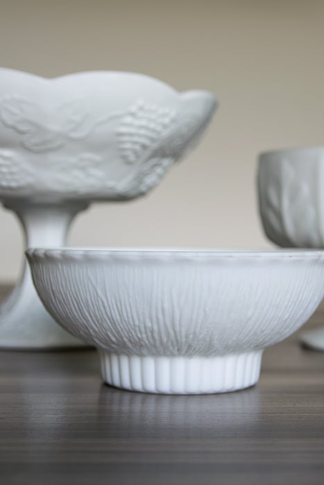 picture showing white pressed glass bowls, varying heights, shapes and textures