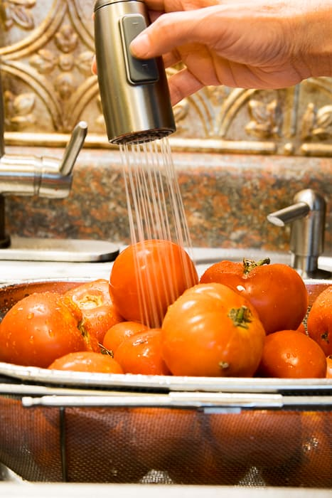 Picture of tomatoes being rinsed with water