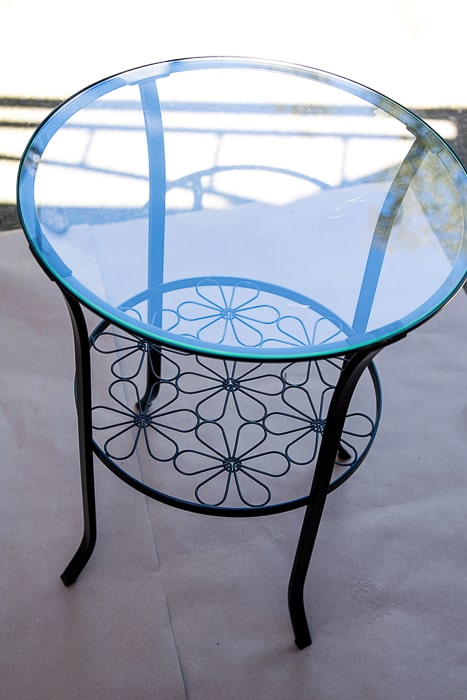 Picture of round black metal table with flowers and glass top