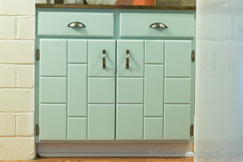the cabinet fronts look like new with updated hardware and a new pale blue paint job