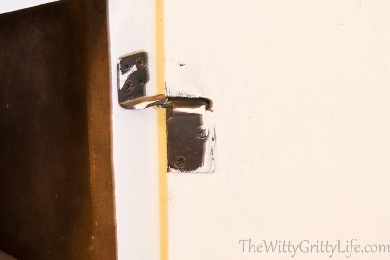 Old and outdated hinge, painted over