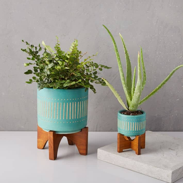 Love the fun turquoise color with the wood legs on these planters!