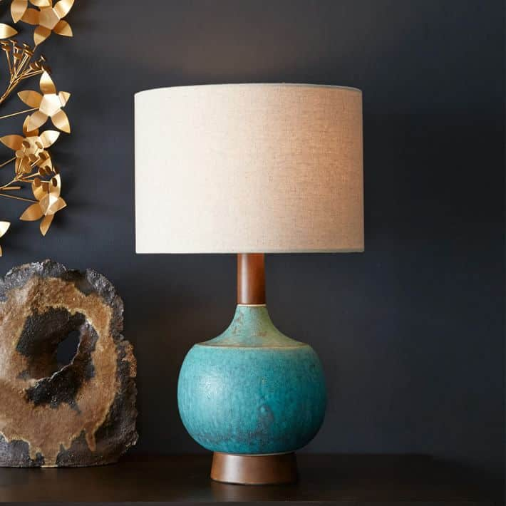 Teal ceramic and wood lamp with a drum shade, mid century modern style