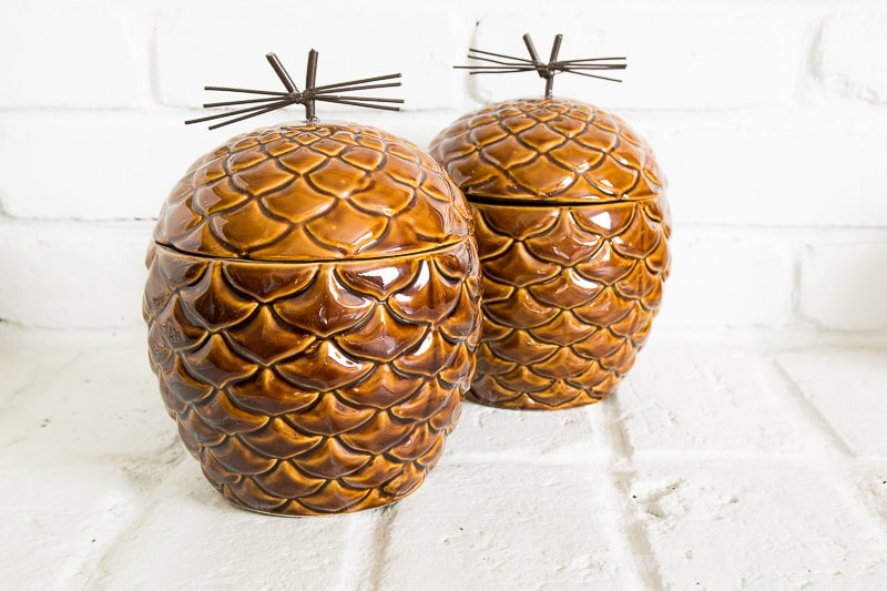 two ceramic pine cone cookie jars