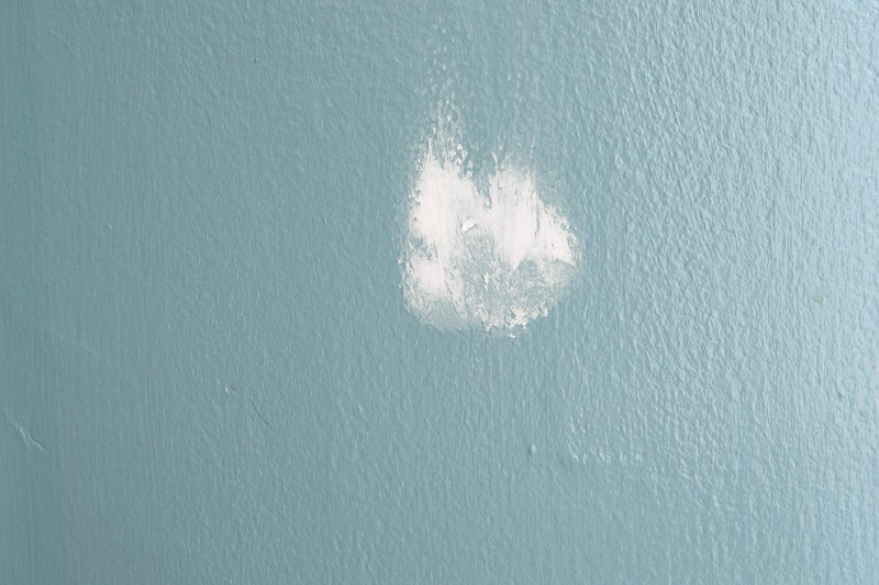 example of a hole in the wall patched with spackle