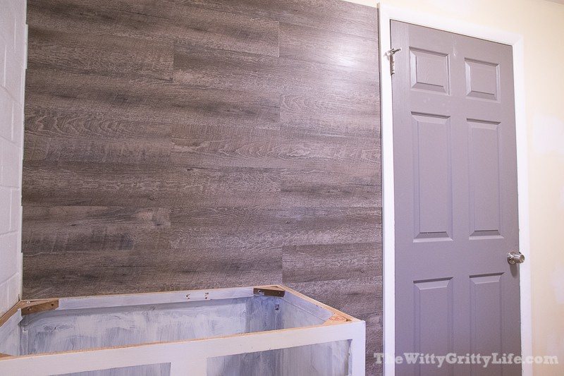 partially completed vinyl plank wall