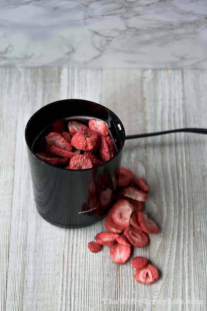 freeze dried strawberries ground into a powder with a coffee grinder
