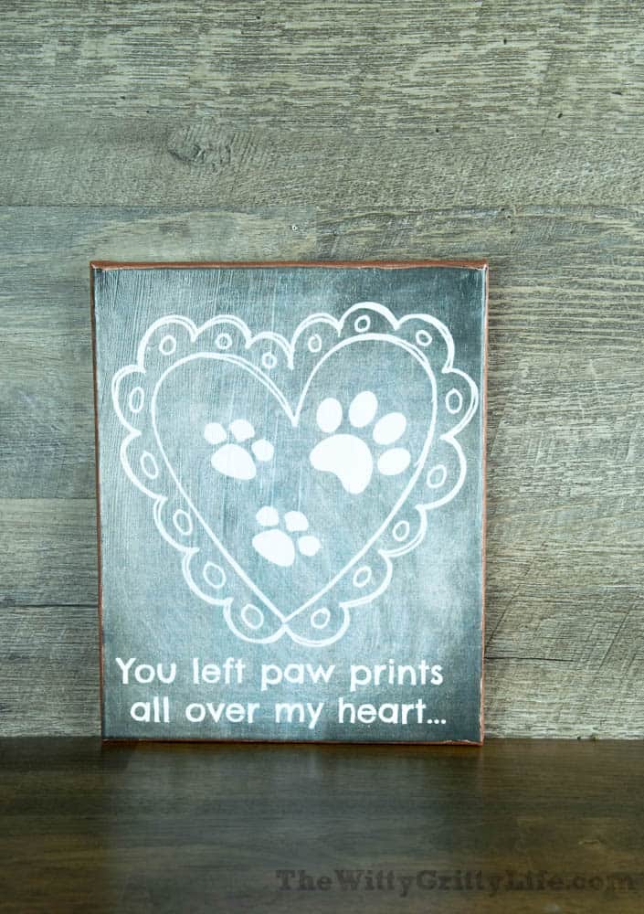 "Diy wall sign with quote ""you left paw prints all over my heart""."