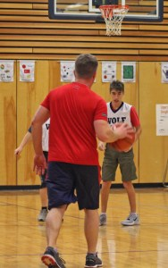 A student moves down the court