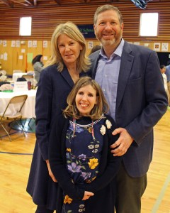 Mark and Katherine Pelson pose with their daughter and one of Wolf's first students, Sarah.