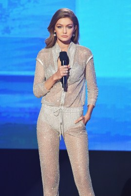 LOS ANGELES, CA - NOVEMBER 20: Co-host Gigi Hadid speaks onstage during the 2016 American Music Awards at Microsoft Theater on November 20, 2016 in Los Angeles, California. In this photo she is wearing 'Versace' (Photo by Kevin Winter/Getty Images)