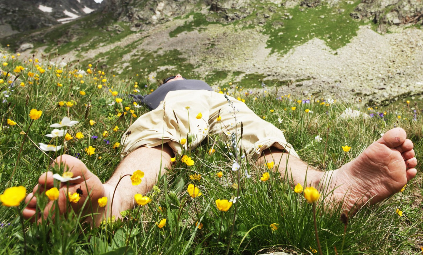Relaxing boy in mountains