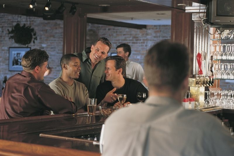 men chatting at bar