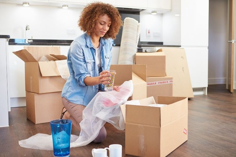 a woman moving into new home