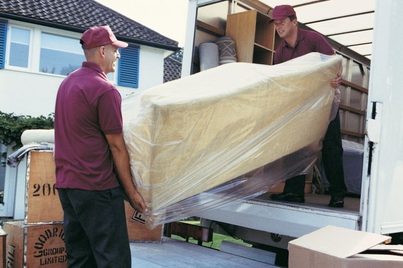 movers moving furniture