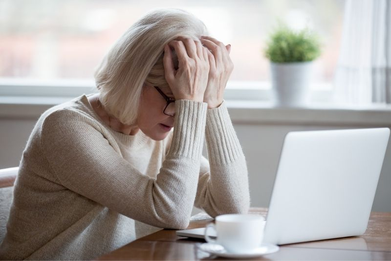 frustrated woman in front of a laptop