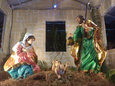 A close up of the near life-size manger