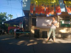 Perri improvising in a street presentation